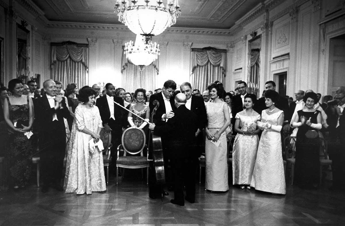 """ST-273-3-61 13 November 1961 President Kennedy greets Pablo Casals after his concert in the East Room of the White House, 13 November 1961, after the State Dinner for Gov. Munoz-Marin of Puerto Rico. Please credit """"Cecil Stoughton, White House/John Fitzgerald Kennedy Library, Boston""""."""
